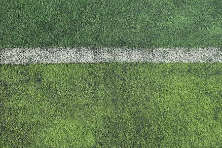 rough soccer field with white stripe background photo