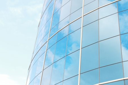 commercial: background of blue sky reflect on glasses from modern business building