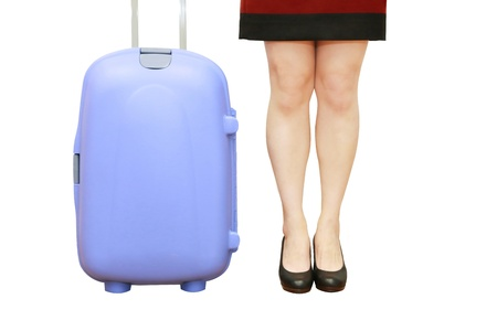 isolated businesswoman legs with a suitcase in white background photo