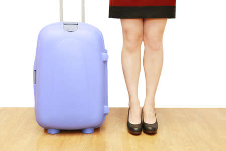 businesswoman legs: isolated businesswoman legs with a suitcase in white background Stock Photo