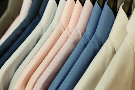 background of shirts hanging on a hanger