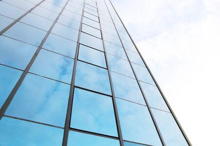 background of blue sky reflect on glasses from modern business building photo