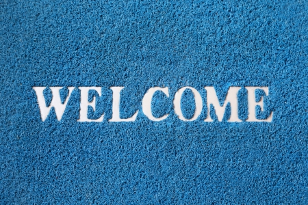 important sign: background of blue welcome carpet Stock Photo