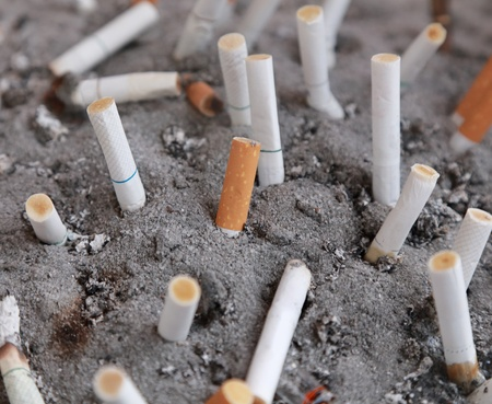 background of cigarette on a sand ashtray photo