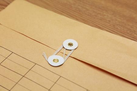 close up image of manila paper envelope photo
