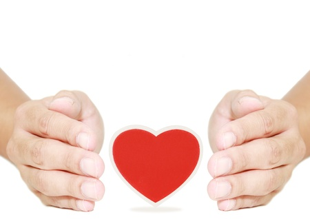 isolated hand protect red heart photo