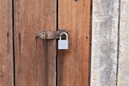 closed metal door lock on a wooden door Stock Photo - 22281037