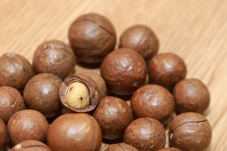 b ball: macadamia nuts on a wooden table