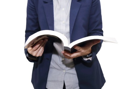 isolated business woman reading a book photo