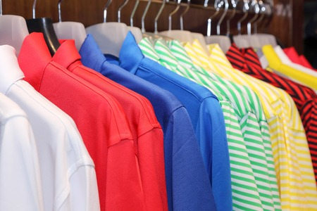 background of colorful polo shirt on a hanger photo