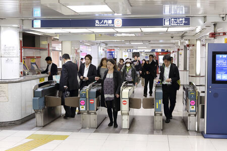 TOKYO -OCT 21   people walking through a ticket gate in Shinjuku train station on 21 October 2013  Shinjuku is one of  the important  district with one of the biggest train station  in Japan