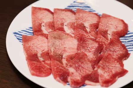 sliced raw beef tongue with salt and pepper for yakiniku photo
