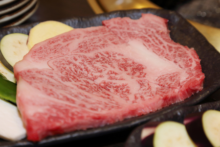 sliced raw hida beef for yakiniku photo
