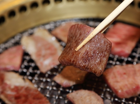 sliced beef  with chopsticks Stock Photo