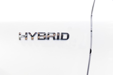 lose up hybrid sign form the car photo