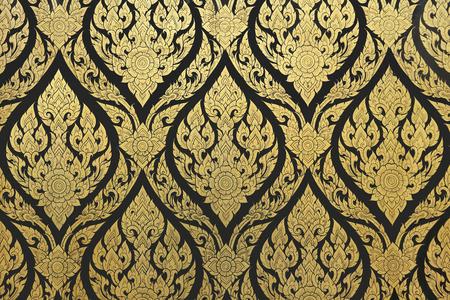 thai style gold painting seamless texture on the temple door 版權商用圖片