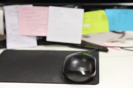 close up mouse in front of black lcd with  post it photo