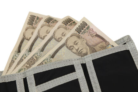 isolated 10000 japanese yen notes in a wallet photo