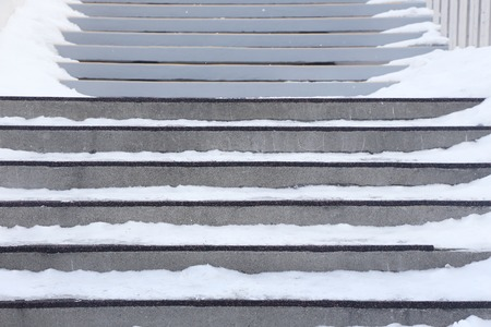 frozen stair steps cover with snow in winter 写真素材