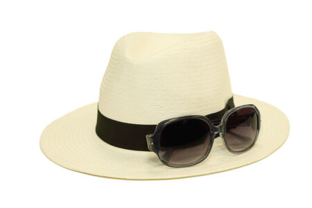 isolated hat with sunglasses in white background photo