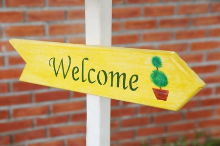 welcome sign on the wooden plate photo