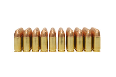 isolated 9 mm bullets on  white background photo