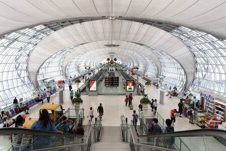 BANGKOK,THAILAND - JULY 11, 2014: passengers walk to the terminal at the Suvarnabhumi Airport, July 11, 2014 in Bangkok, Thailand.The airport is handling about 45 million passengers annually.