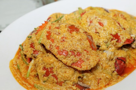 fried crab with curry powder on the plate photo