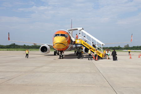 PHITSANULOK, THAILAND - OCTOBER 6 2014: Unidentified group of people walked to Nok Air airplane in Phitsanulok airport , on October6, 2014. Nok Air is one of the biggest low cost airline in Thailand