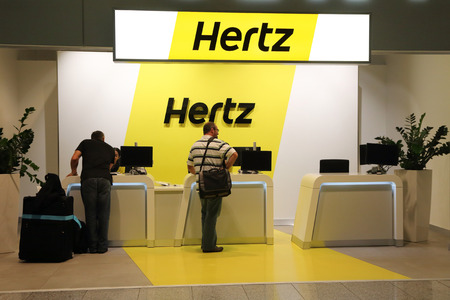 hertz: FRANKFURT, GERMANY - OCTOBER 18:, 2014: people contact the hertz car rental customer service at the Frankfurt Airport, Germany on October 18, 2014.