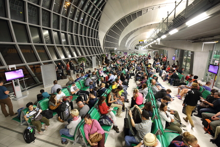 BANGKOK -OCTOBER 17: ]group of people wait for the plane at the departure terminal of Bangkok Suvarnabhumi International Airport on October 17, 2014 in Bangkok, Thailand.This airport is handling about 45 million passengers annually.