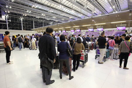 BANGKOK -OCTOBER 17: 2014: passengers wait for the plane at  the  Suvarnabhumi Airport, October 17, 2014 in Bangkok, Thailand.The airport is handling about 45 million passengers annually.