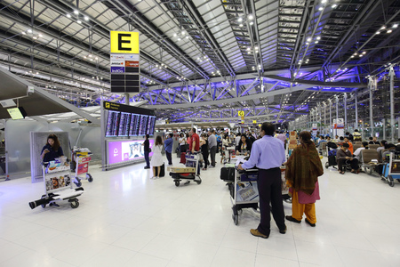 BANGKOK -OCTOBER 17: 2014: passengers walk to the terminal at the Suvarnabhumi Airport, October 17, 2014 in Bangkok, Thailand.The airport is handling about 45 million passengers annually.