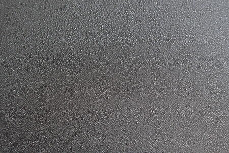 abstract background of drops of rain on the glass photo