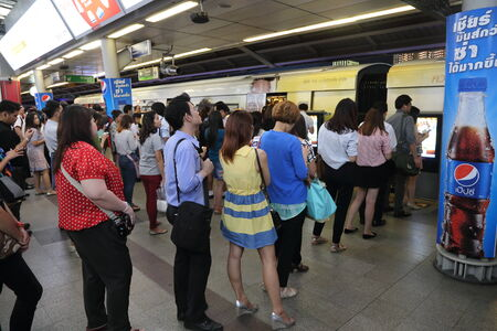 BANGKOK - DECEMBER 11: Passengers waiting for a BTS Skytrain at a siam station in rush hour on December 11, 2014 in Bangkok Thailand.