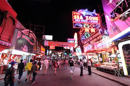 brothel: PATTAYA, THAILAND - DECEMBER 13: Unidentified tourist walk through the Walking Street  in Pattaya on December 13, 2014 . Walking Street is a popular tourist attraction in pattaya Editorial