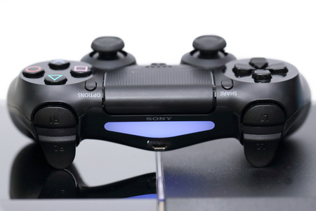 joy pad: THAILAND -JANUARY 10: the new sony dualshock 4  with PlayStation 4 taken in Bangkok Thailand on January 10,2015.
