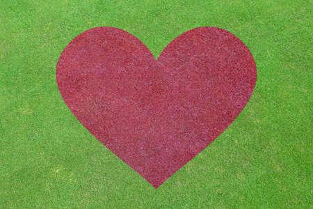 symbol sport: Hintergrund der gr�nen Wiese mit roten Herz-Form