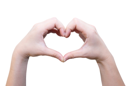 isolated female hand in heart shape photo