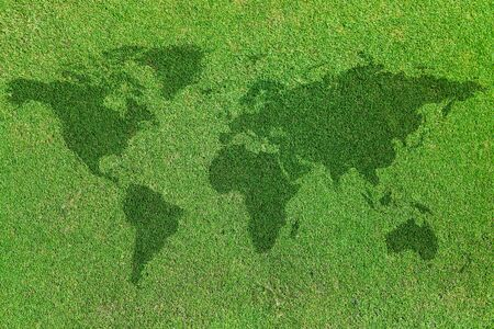 background of world map on green grass field photo