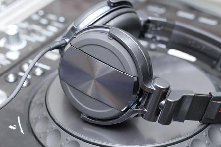 background of Dj mixer and vinyl player with headphones