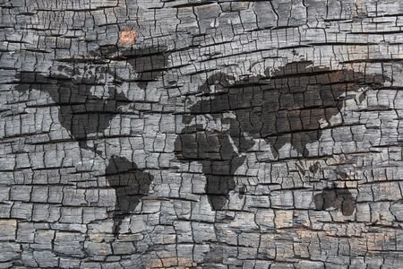 burnt wood: background of burnt wood texture with world map Stock Photo