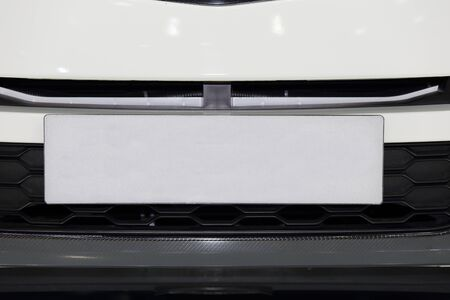 number plate: white car from front view with empty white number plate