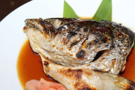 tekka: background of japanese food salmon kabutoni or grilled salmon head with soy sauce Stock Photo