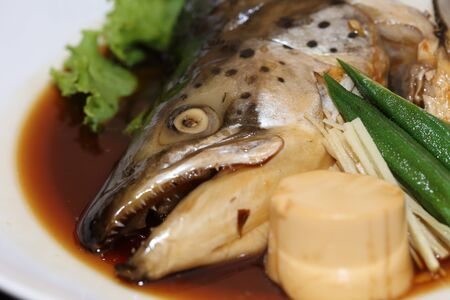 tekka: background of japanese food salmon kabutoni or steamed salmon head with soy sauce Stock Photo