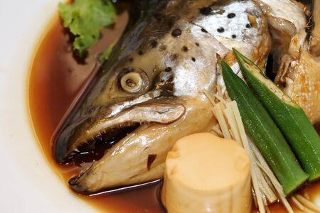 tekka: background of japanese food salmon kabutoni or steamed salmon head with soy sauce Stock Photo