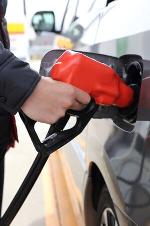 fill up: background of hand filling the car fuel of the car