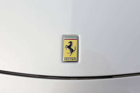 racer flag: KYOTO, JAPAN -APRIL 12, 2015: The Logo of Ferrari car on April 12, 2015 in Japan