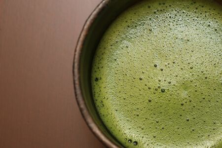 close-up of a cup of japanese matcha green tea photo