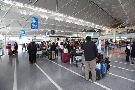 chubu: NAGOYA, JAPAN- APRIL 15, 2015: Unidentified people travel at  Chubu Centrair International Airport on April 15,2015 in Nagoya Japan.Chubu airport is an airport on an artificial island in Ise Bay Aichi.
